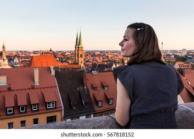View of a girl watching the Nuremberg city in the evening