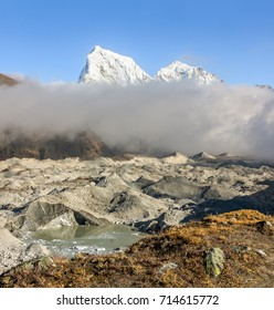 View of the glacier Gokyo with peaks Khangchung (6103 m) on a sunny day - Gokyo region, Nepal, Himalayas