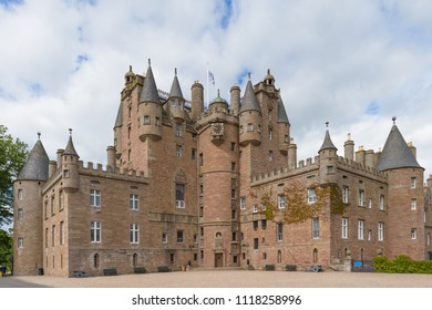 View of Glamis Castle in Angus, Scotland, United Kingdom. Glamis Castle is situated close to the village of Glamis and is the home of the Earl of Strathmore and Kinghorne.