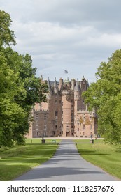 View of Glamis Castle from the driveway in Angus, Scotland, United Kingdom. The Castle is situated close to the village of Glamis and is the home of the Earl of Strathmore and Kinghorne.
