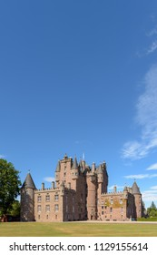 View of Glamis Castle in Scotland. Glamis Castle is situated close to the village of Glamis in Angus. It is the home of the Earl and Countess of Strathmore and Kinghorne, and is open to the public.