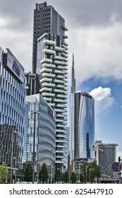"""view of glass buildings and skyscraper from """"via della liberazione"""" (liberation avenue) in Milan city. italy-Milan 20 April 2017"""