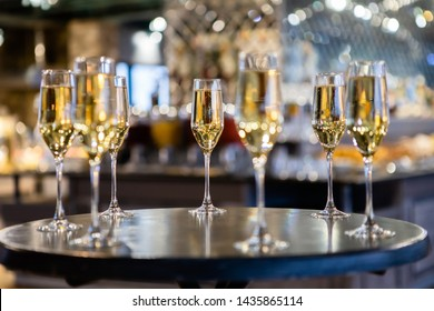 View of glasses filled with champagne,  welcome drink on a table in a restaurant