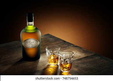 view of glasses of  rum and a bottle aside on color background. self made label.