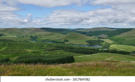 View of Glendevon, Castlehill Reservoir and Ochil Hills from the peak of a hill above Muckhart