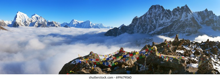 view from Gokyo Ri to Arakam Tse, Cholatse, Tabuche Peak, Thamserku and Kangtega with prayer flags - trek to Everest base camp - Nepal