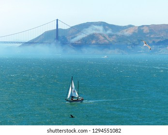 View of Golden Gate bridge covered by fog from Alcatraz island.