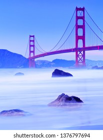 View of Golden Gate Bridge from Marshall's Beach in San Francisco at twilight.