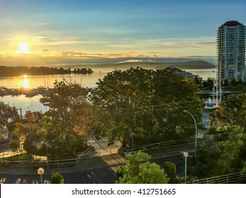A view of the golden sunrise on the harbour in Nanaimo, British Columbia