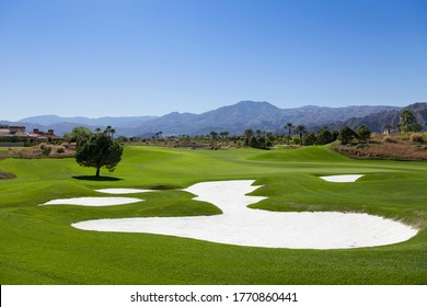 View of golf course with sand traps
