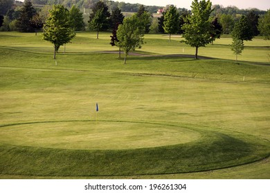 View of golf green with balls