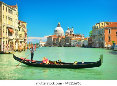 View of gondola on Grand Canal and Basilica Santa Maria della Salute, Venice, Italy