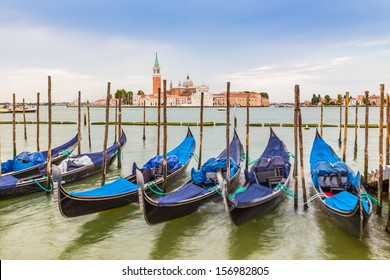 view of gondolas and San Giorgio church as background in Venice, Italy