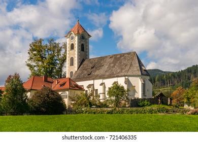 View of the gothic-baroque style parish church in Obermuehlbach in Carinthia, Austria.