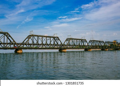 View of Government Bridge over Mississippi River under blue sky and clouds in Davenport, Iowa, USA
