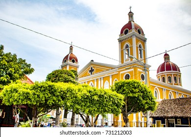 View of Granada Cathedral Peeking over Trees, at the Center of Parque Central De Granada in Nicaragua