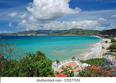 View of Grand Anse beach and tropical coast of Grenada island from coastal promenade