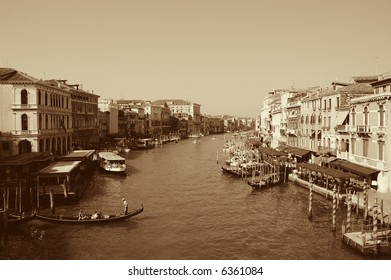 View of the Grand Canal from the famous Rialto bridge shows boats, stations, restaurants, etc.