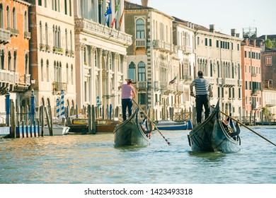 View of the Grand Canal from a gondola in Venice, Italy. Gondoliers on gondolas on the background of the views of Venice