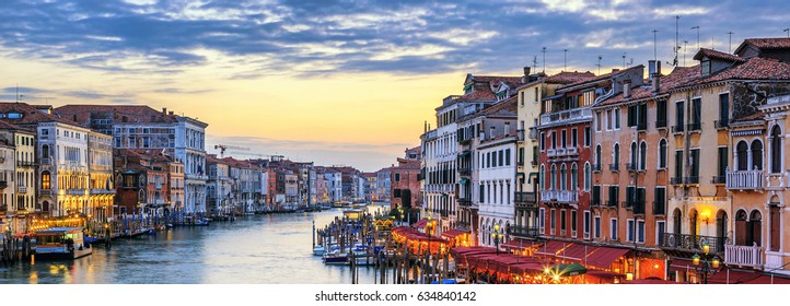 View of Grand Canal with gondolas at sunset in Venice