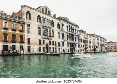 View of the Grand Canal (Canal Grande). Beautiful ancient architecture traditional buildings located near the Grand Canal. Venice, Italy.