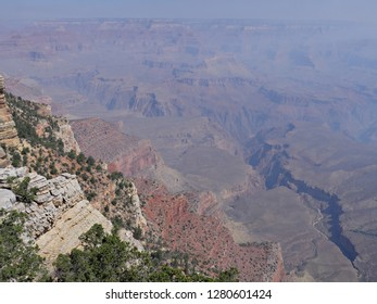 View of the Grand Canyon National Park from the South Rim on a hazy day with smoke from a wildfire.