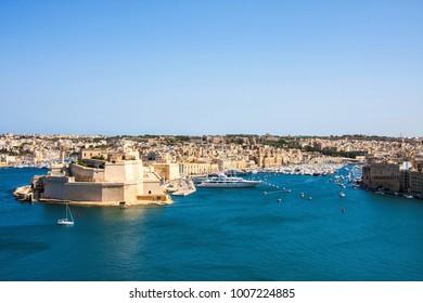 View to Grand Harbor from Upper Barrakka Gardens at sunset, Valetta, Malta