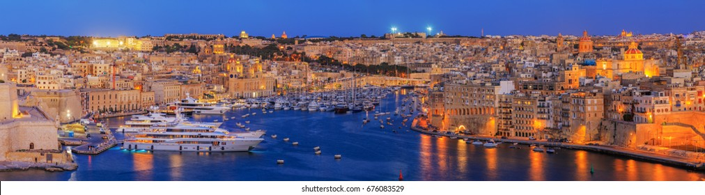 View to Grand Harbor from Upper Barrakka Gardens at sunset, Valetta, Malta