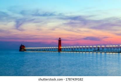View of the Grand Haven South Pierhead Inner and Outer Lighthouses at sunset; Grand Haven State Park, Lake Michigan