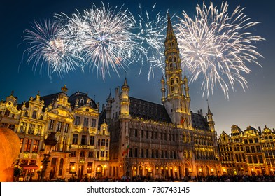 View of the Grand Place (Grote Markt) at night with fireworks on the black sky in Brussels, Belgium
