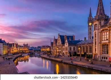View of Graslei, Korenlei quays and Leie river in the historic city center in Ghent (Gent), Belgium. Architecture and landmark of Ghent. Sunset cityscape of Ghent.