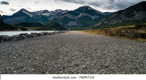 View of a gravel walking path along Barrier Lake in Kananaskis, Alberta