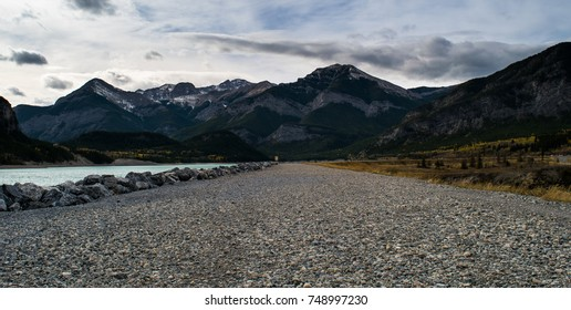 View of a gravel walking path along Barrier Lake in Kananaskis, Alberta