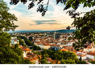 View at Graz city with his famous buildings. River mur, clock tower, art museum, town hall. Famous tourist destination in Austria