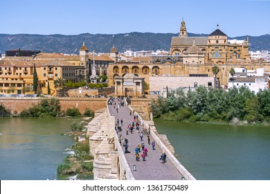 View of the Great Mosque–Cathedral and the Roman bridge across the Guadalquivir river in Cordoba, Andalusia, Spain