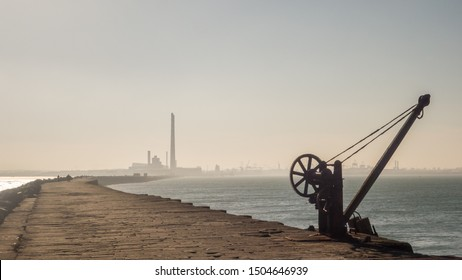 View from the Great South Wall in Dublin Bay, Ireland. The towers of Poolbeg power station and the Port of Dublin can be seen in the distance.