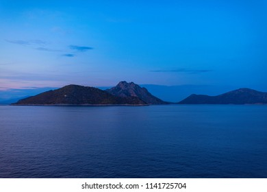View of the Greek island of Atokos from the ferry at sunset. Greek islands in the Ionian Sea