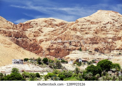 View of Greek Orthodox Monastery of the Temptation or Qarantal in the Judean Desert above Jericho city, Palestine, Israel. This place is know as hill where Jesus was tempted by the devil (Matthew 4:8)