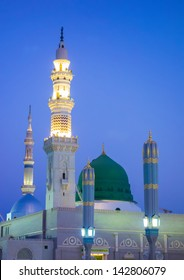 View of green dome of Nabawi Mosque in the morning during sunrise in Al Madinah, Saudi Arabia.