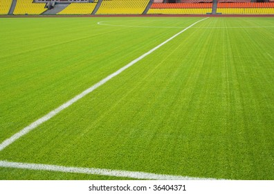 View of the green grassy artificial lawn on football/soccer field