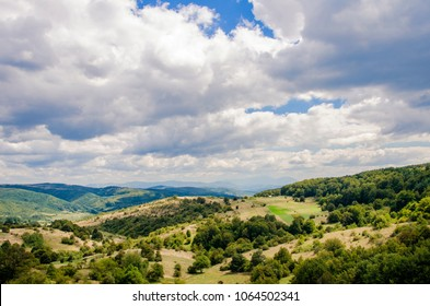 View at green hills under summer sky on Rtanj mountain in Serbia