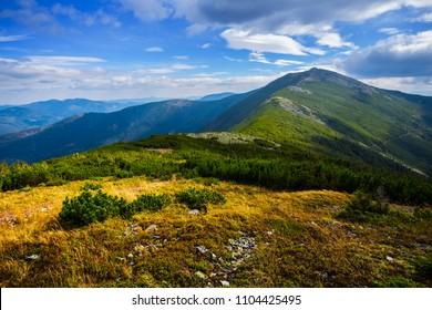 view to a green mountain ridge