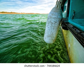 View of Green Ocean Waves from Boat Board, summer sunny day