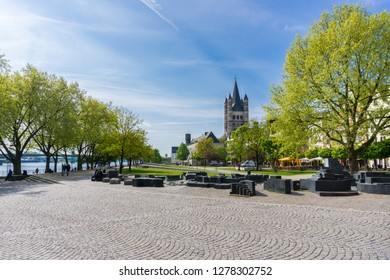 View of green trees and an old church in the old town of Cologne on the Rhine on a sunny day with blue sky in Germany Cologne 2018.