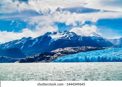View of Grey Glacier and Grey Lake with the snowy mountain in sunny day at Torres del Paine National Park in Southern Chilean Patagonia