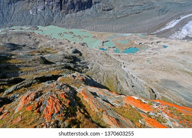 View of Grossglockner, melted snow, moraine and crevasses at Pasterze Glacier, Hohe Tauern National Park in Austria. It is the longest mountain glacier in Austria at approximately 8.4 kms in length