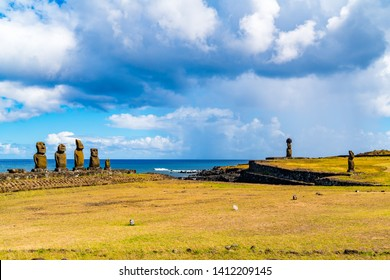 View of the group of five Moai Statues Ahu Vai Uri, Ahu Ko Te Riku with hat and Ahu Tahai in The archaeological site of Tahai on Easter Island in Chile