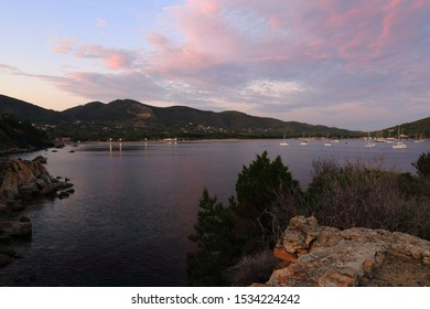View of the Gulf of Lacona, Isola Elba, Italy, at sunset with pink clouds