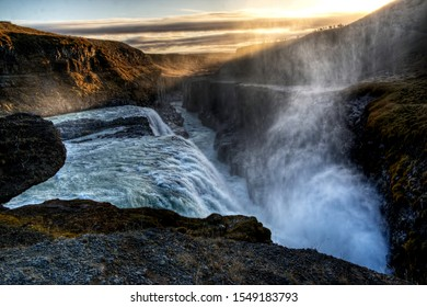 View of the Gullfoss waterfall, part of the golden circle in Iceland, at sunset
