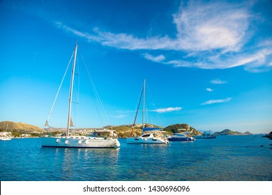 View of the Gumusluk Bodrum Marina, sailing boats and yachts in Bodrum town, city of Turkey. Shore and coast of Aegean Sea with yachts and boats